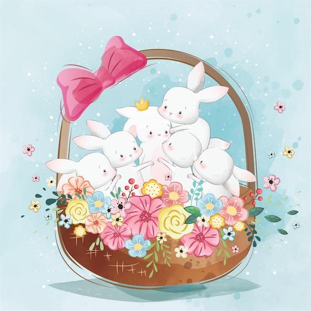 Lapins mignons dans le panier de printemps Vecteur Premium