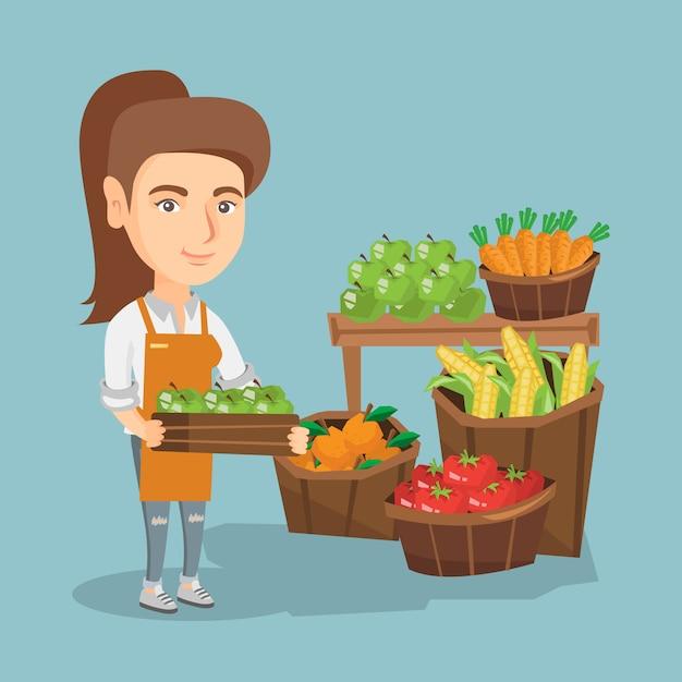 Légumes caucasiens tenant une boîte aux pommes. Vecteur Premium