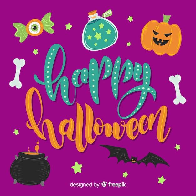 Lettrage d'halloween heureux avec citrouille et os Vecteur gratuit