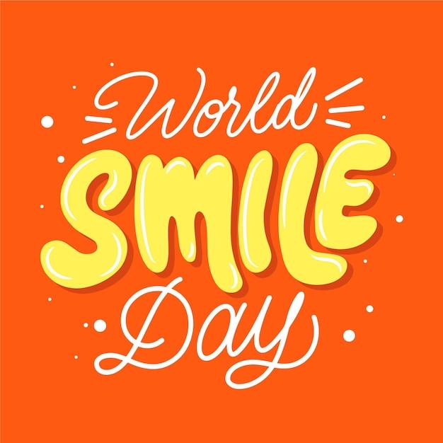 Lettrage De La Journée Mondiale Du Sourire Vecteur gratuit
