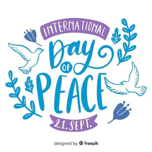 Lettrage de la journée de la paix universelle Vecteur gratuit