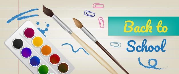 Lettrage de rentrée scolaire sur du papier ligné avec des peintures et des pinceaux Vecteur gratuit