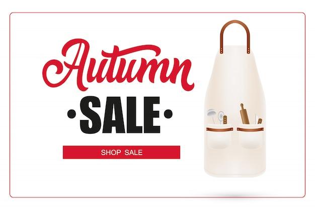 Lettrage de vente d'automne dans le cadre et tablier avec des ustensiles de cuisine Vecteur gratuit