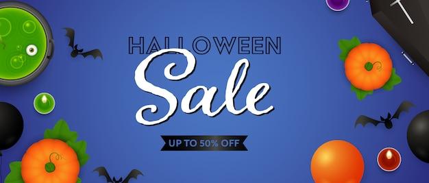 Lettrage de vente d'halloween, citrouilles, potions et bougies Vecteur gratuit