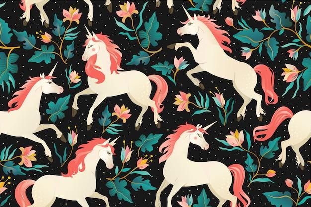 Licornes sur un motif sombre sans soudure Vecteur Premium