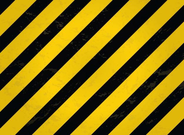 Ligne noire et jaune rayée. avertissement fond grunge rayé. Vecteur Premium