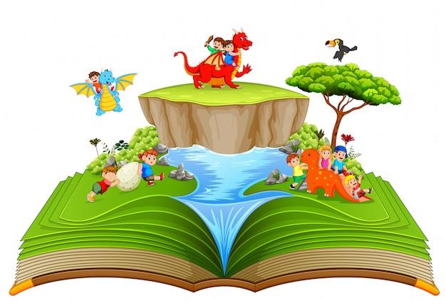 Le livre de contes vert des enfants jouant avec le dragon près de la rivière Vecteur Premium