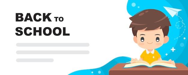 Livre de lecture de garçon mignon à la page de destination de l'école Vecteur Premium