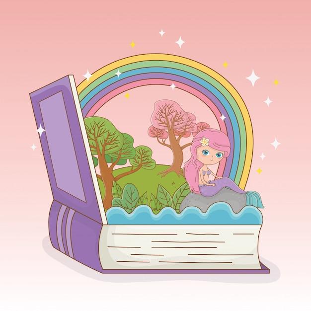 Livre ouvert avec sirène de conte de fées et arc-en-ciel Vecteur gratuit