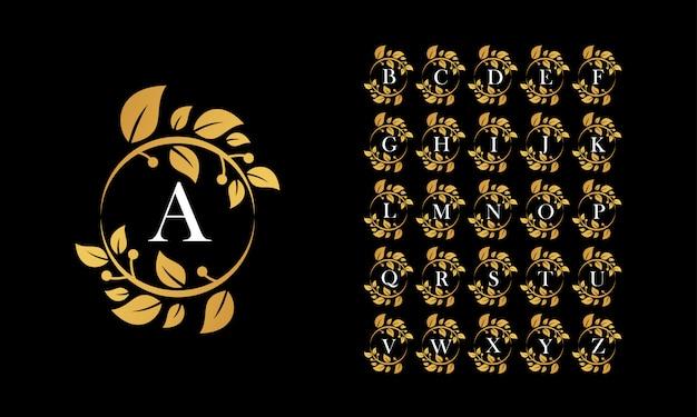 Logo de couronne de feuilles d'or avec l'alphabet Vecteur Premium