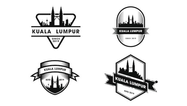 Logo D'insigne De Kuala Lumpur. Silhouette De Kuala Lumpur Et Monuments Vecteur Premium