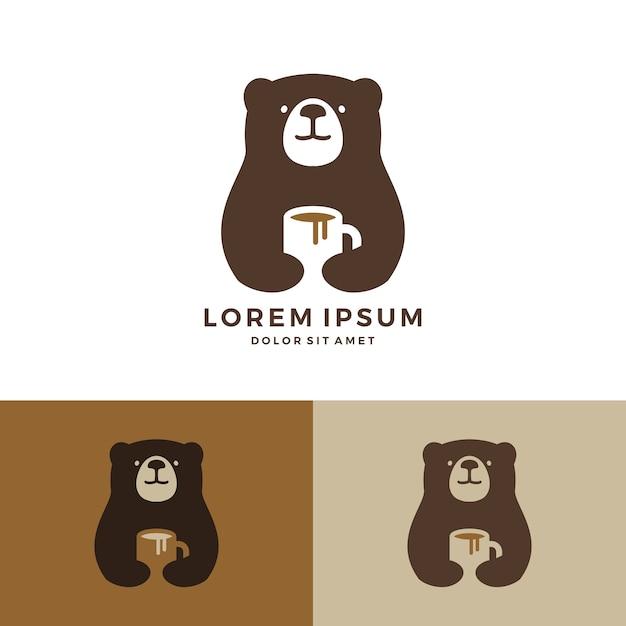 Logo d'ours de café tenant le logo de tasse Vecteur Premium