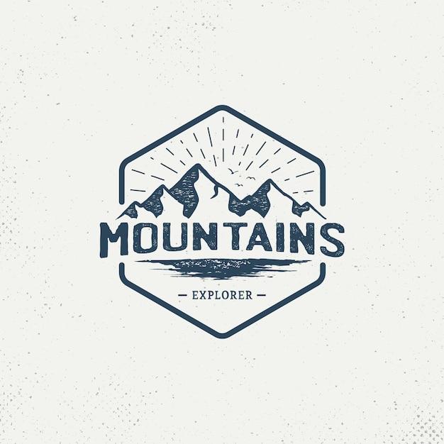 Logo vintage badge mountain Vecteur Premium