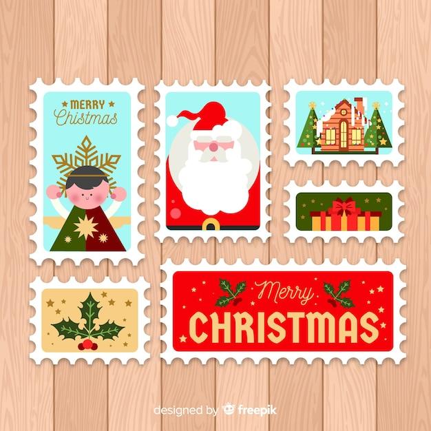 Lot de timbres postaux de noël plats Vecteur gratuit
