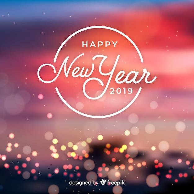 Lumières brouillées fond de nouvel an Vecteur gratuit