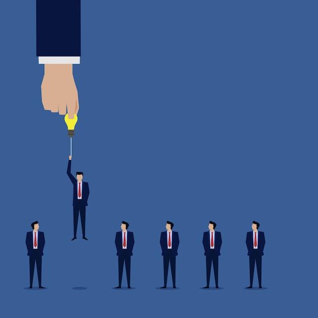 Main choisir homme d'affaires avec l'idée au niveau supérieur suivant. Vecteur Premium