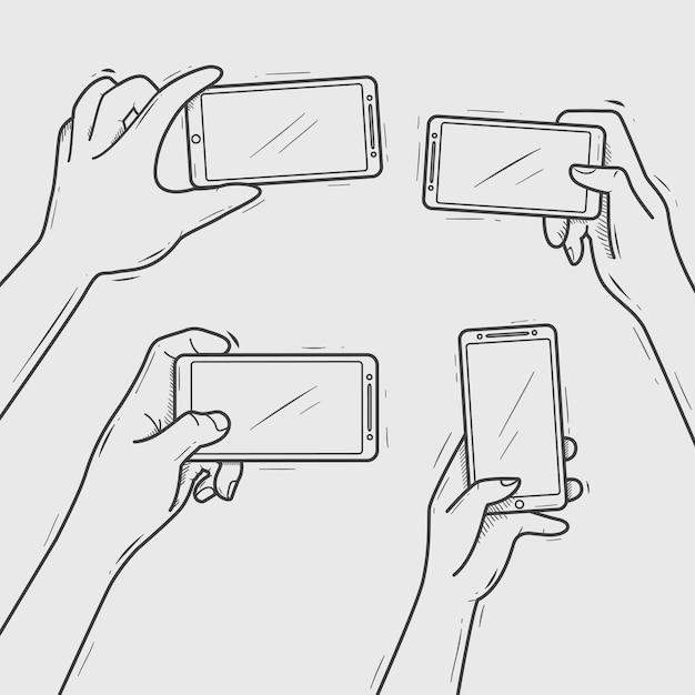 Main dessiné mains tenir smartphone prenant selfie et photo Vecteur Premium