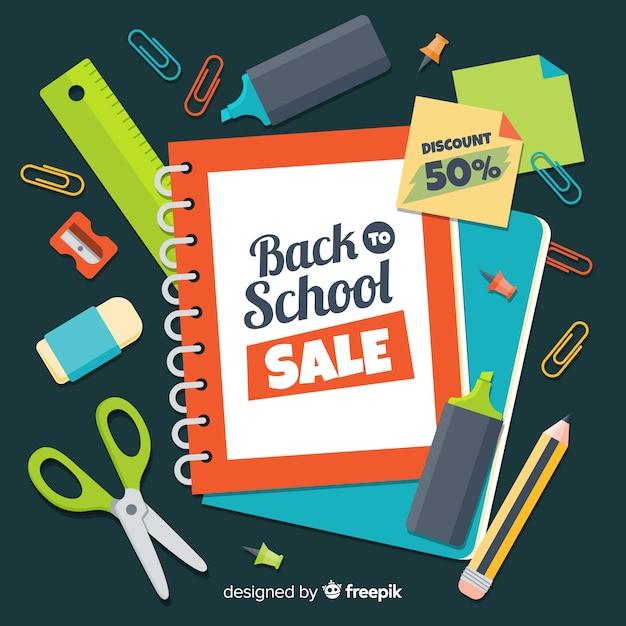 Main dessinée à l'arrière-plan des ventes scolaires Vecteur gratuit