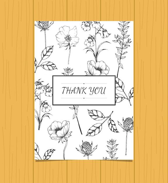 Main dessinée de carte de remerciement florale Vecteur Premium