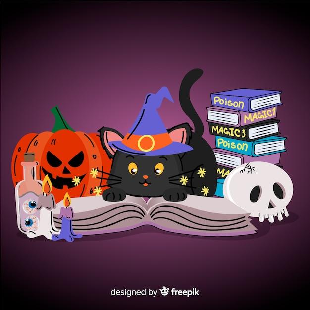 Main dessinée chat halloween avec des livres Vecteur gratuit