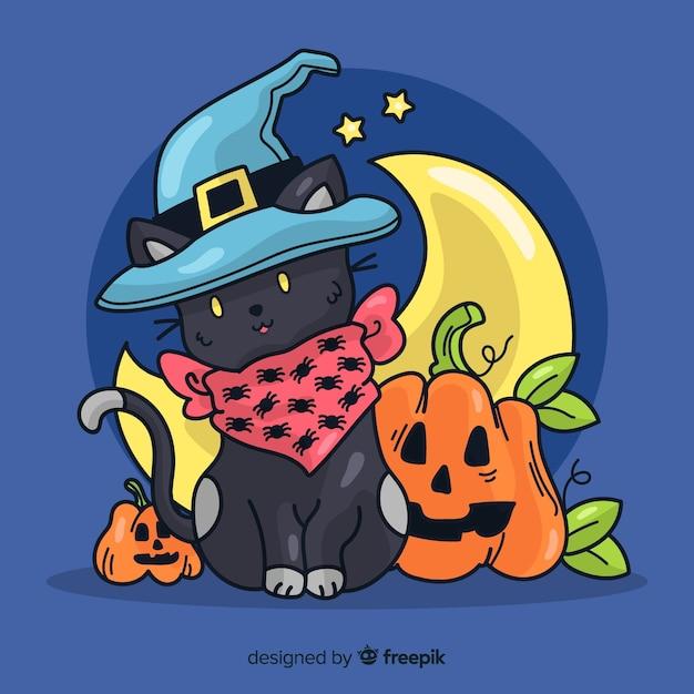 Main dessinée chat noir halloween Vecteur gratuit
