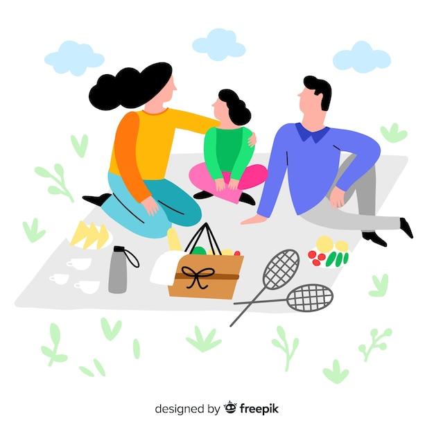 Main dessinée famille ayant une illustration de pique-nique Vecteur gratuit