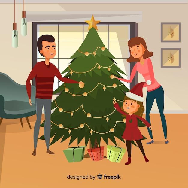 Main dessinée famille décorer fond de noël arbre de noël Vecteur gratuit
