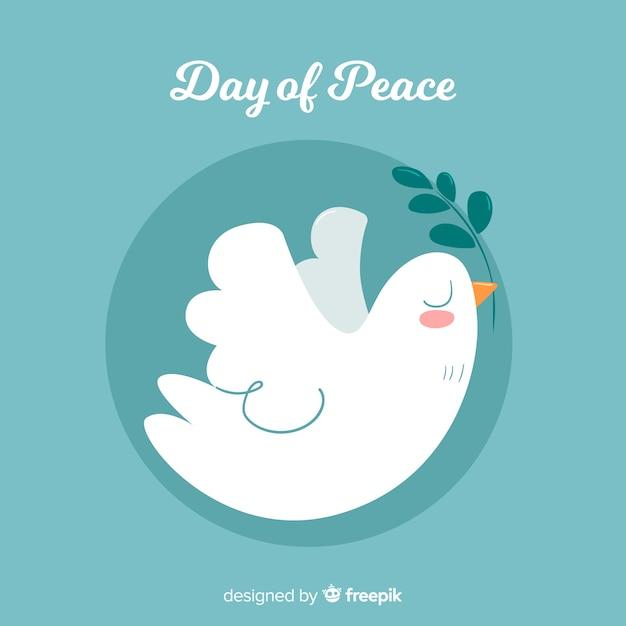 Main dessinée fond de jour de la paix avec la colombe Vecteur gratuit
