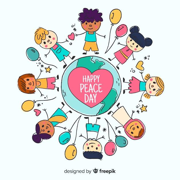 Main dessinée fond de jour de la paix avec les enfants Vecteur gratuit