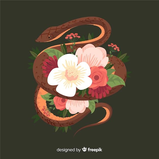 Main dessinée serpent entouré de fleurs Vecteur gratuit