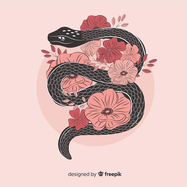 Main dessinée serpent avec illustration de fleurs Vecteur gratuit