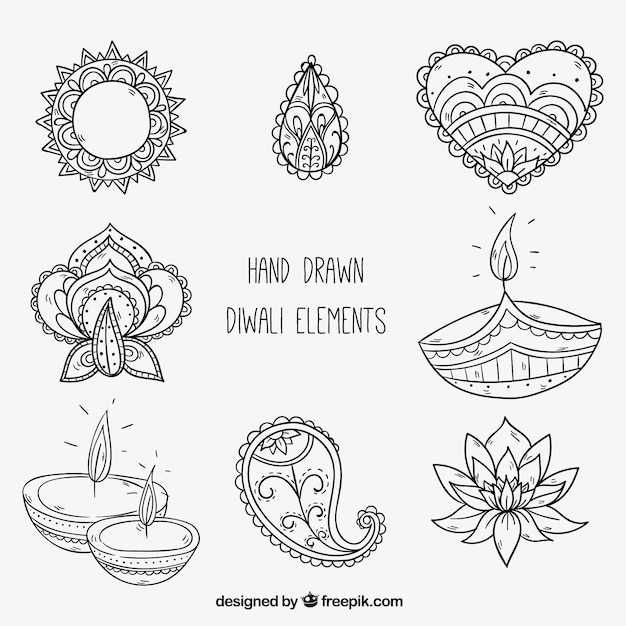 Main diwali dessiné des éléments décoratifs Vecteur gratuit