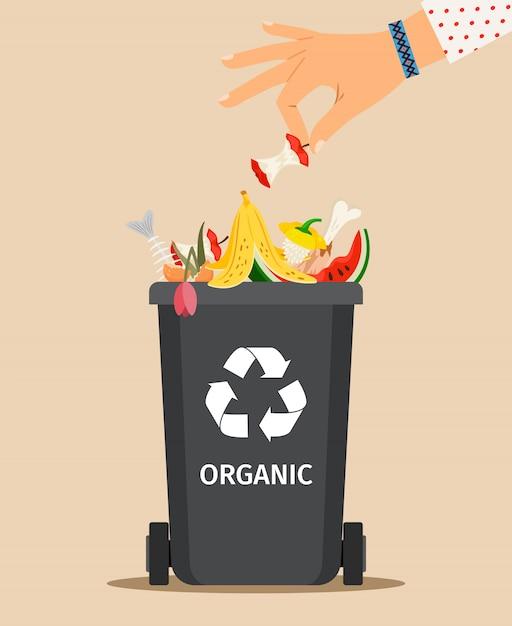 Main de femme jette des ordures organiques Vecteur Premium