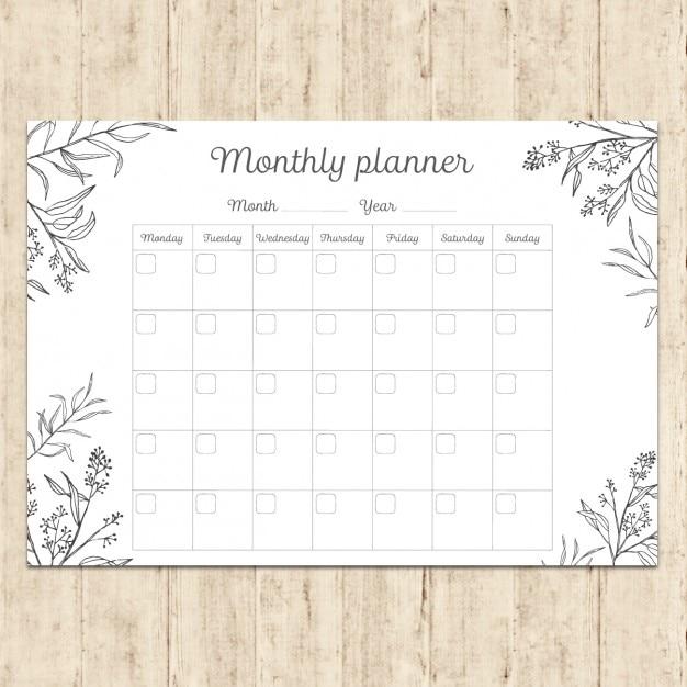 Main planificateur mensuel peint Vecteur gratuit