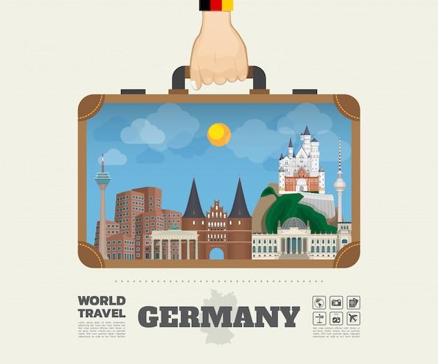 Main portant le sac d'infographie allemagne landmark global travel and journey. Vecteur Premium