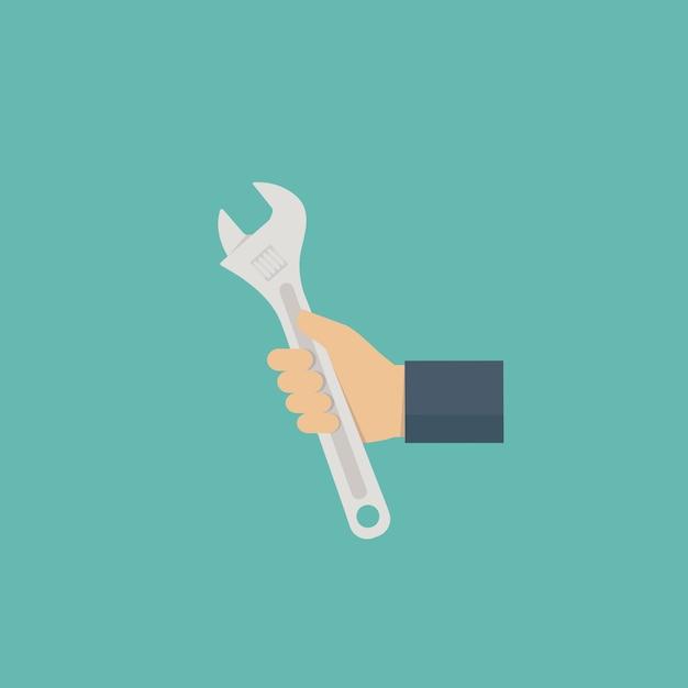 Main de technicien avec une clé Vecteur Premium