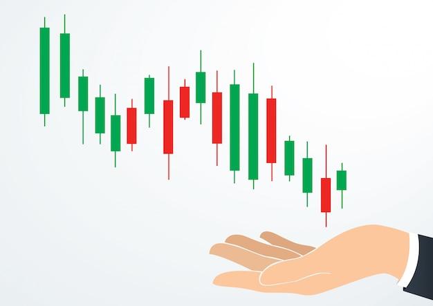 Main tenant bougie graphique bourse Vecteur Premium