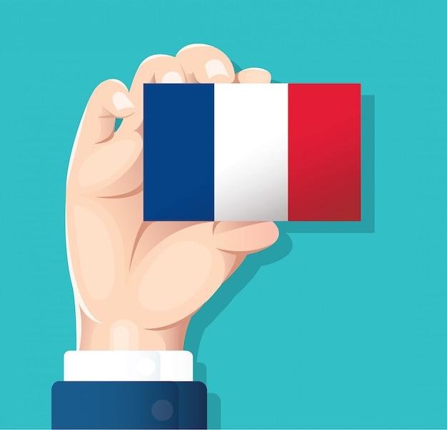 Main tenant la carte drapeau france Vecteur Premium