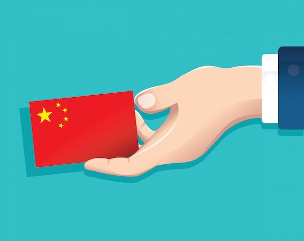 Main Tenant La Carte Du Drapeau Chinois Vecteur Premium