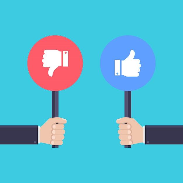 Main tenant le panneau, aime et n'aime pas les icônes Vecteur Premium