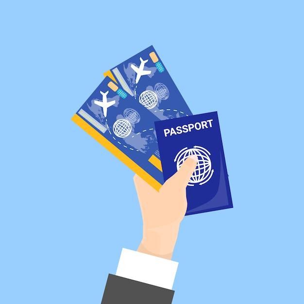 Main tenant un passeport et des billets isolés Vecteur Premium