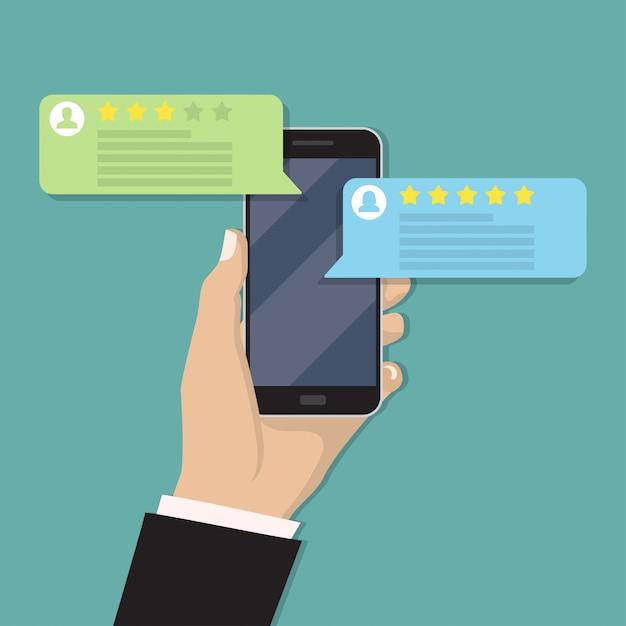 Main tenant un smartphone avec avis Vecteur Premium