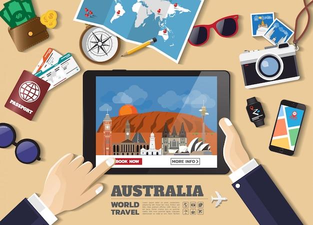 Main tenant la tablette intelligente réservation destination voyage. australie lieux célèbres Vecteur Premium