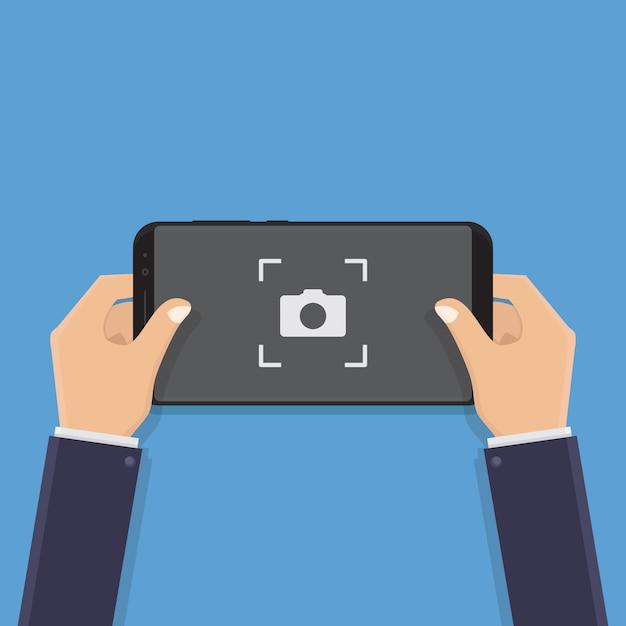 Main tenant un téléphone intelligent, prendre des photos, illustration Vecteur Premium