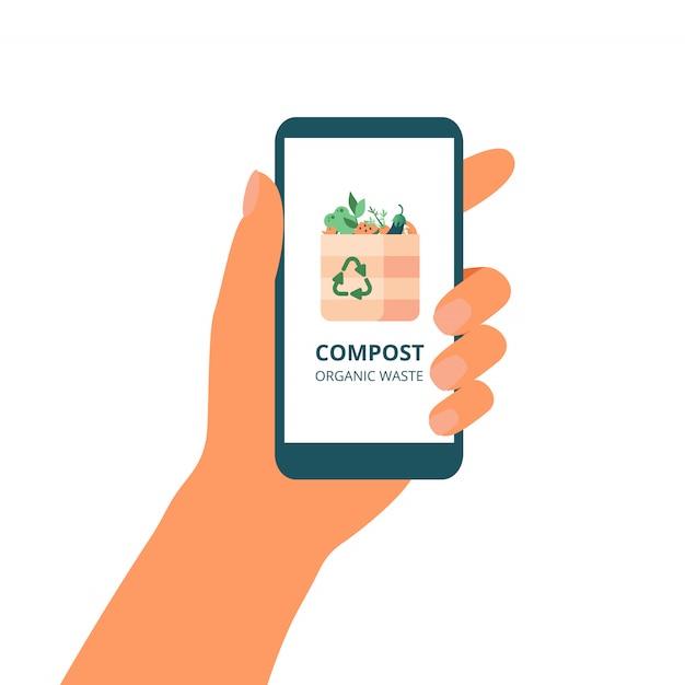 Main tient un téléphone mobile avec le concept vert de compostage sur l'écran. Vecteur Premium