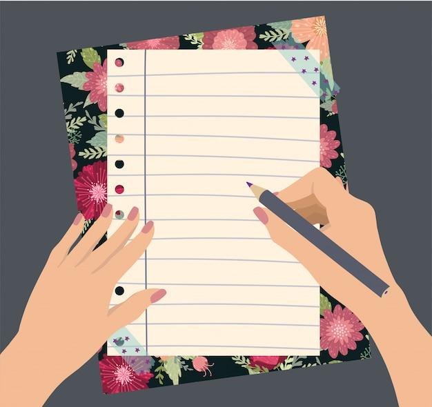 Mains féminines tenir un crayon avec de belles fleurs bloc-notes Vecteur Premium