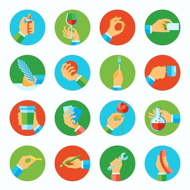 Des mains humaines tenant des objets plats plats icônes définies illustration vectorielle isolé Vecteur gratuit