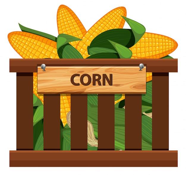 Maïs sucré dans une caisse en bois Vecteur Premium