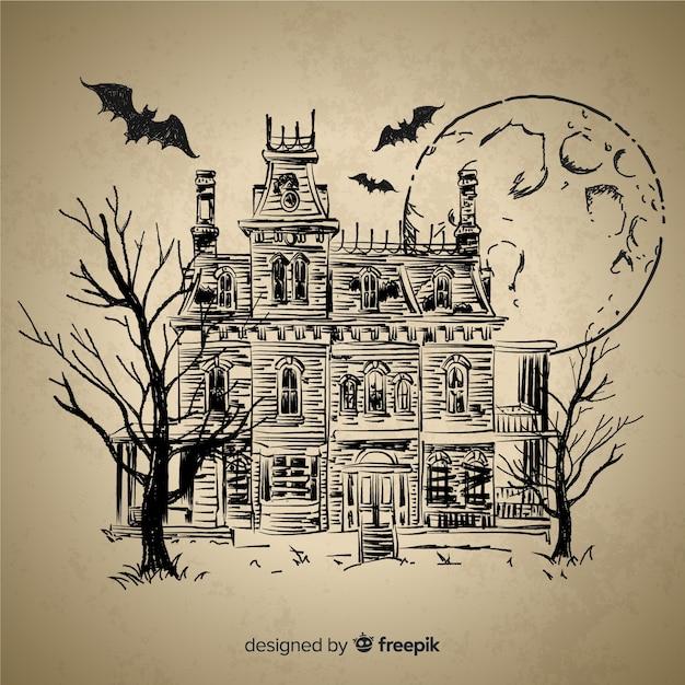 Maison d'halloween dessiné à la main Vecteur gratuit