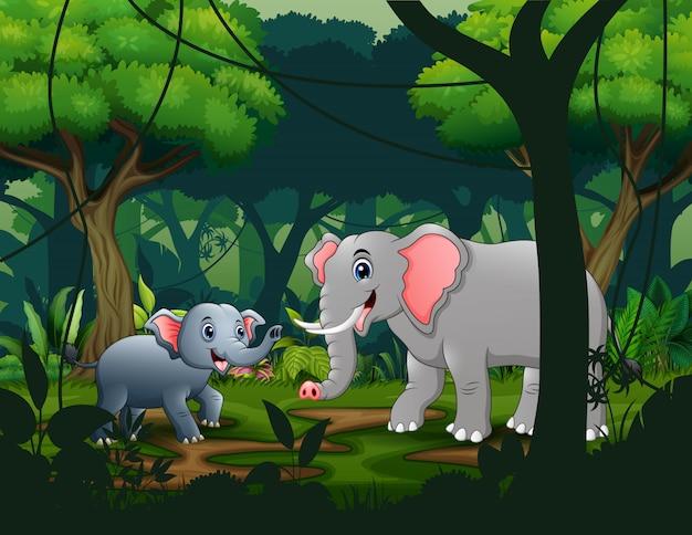 Maman Et Jeunes éléphants Dans La Jungle Vecteur Premium